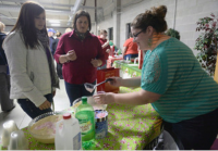 "Times-Gazette photo/Sarah Gordon Brittany Ison, right, with Ashland Parenting Plus serves ""Peppermint Eggnog Punch"" to Liz Jones, center, and her daughter, Ellen, during Thursday's Mocktail Mixer put on by Ashland County Safe Communities Coalition at the Sheriff's Annex."
